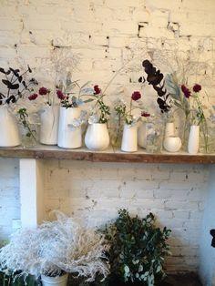Vaser med blomser i