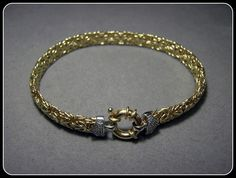 14k Solid Yellow Gold Byzantine Bracelet with Diamond Pave accents.