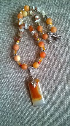 Polished orange agate pendant hangs on necklace of dragons vein agate. Dragon Eye, Agate Beads, Hippy, Dragons, Beaded Necklace, Etsy Shop, Drop Earrings, Gemstones, Jewellery