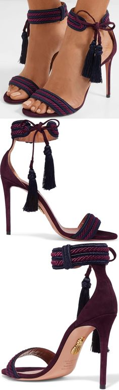 Aquazzura's 'Shanty' sandals are crafted from velvety suede with tasseled ties for a playful edge. Braided trims highlight the two-tone purple hues while the sleek stiletto adds to their leg-lengthening appeal.