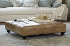 Low profile tufted light cream leather Ottoman coffee table in square shape