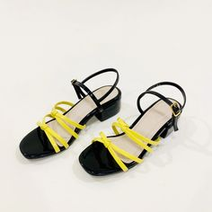 total heel height padded sole High quality patent leather contrasting colors runs small in size due to strap style, regular to wide feet please go size up Wide Feet, Strappy Heels, Sicily, Black N Yellow, Indiana, Patent Leather, Knots, Style, Fashion