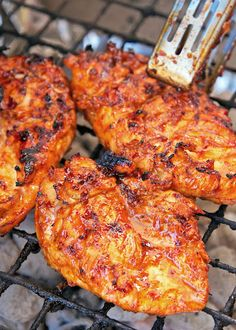 Sweet and Spicy Italian BBQ Grilled Chicken - only 4 ingredients in the marinade! BBQ sauce, Italian dressing, chili powder and red pepper flakes. Sweet and spicy! SO delicious! We make this once a week. Everyone cleans their plate. The chicken is so juicy and has TONS of flavor! We never have any leftovers.