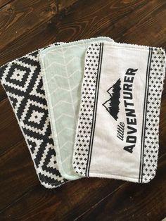 I like this Little Adventurer Burp material set, mint chevron, black aztec, child present, bathe present
