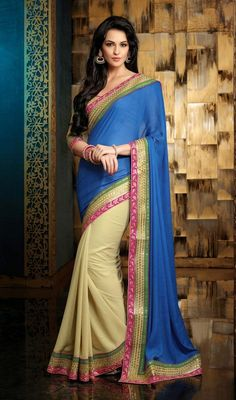Shine like a star wearing this blue, cream shimmer chiffon and jacquard half n half sari. The pretty lace, resham and sequins work throughout the saree is awe-inspiring. Upon request we can make round front/back neck and short 6 inches sleeves regular saree blouse also. #AwesomeDesignerSareeCollection