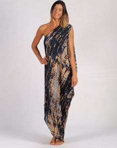 This Grecian style, asymmetric one shoulder dress is simply amazing! Wear with wedges or sandals and try belting for a different look. Either way, you will look incredible as this dress is so flattering  Features: - One shoulder - Batwing sleeve - Navy blue/grey/brown tie dye - Diagonal hem