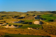The golf course wasn't so much designed as discovered. Bill Coore and Ben Crenshaw trudged back and forth over a thousand acres of rolling sand hills in central Nebraska, flagging out naturally-occurring fairways and greens. By moving just 4,000 cubic yards of earth, and letting the winds shape (and reshape) the bunkers, the duo created what is undoubtedly the most natural golf course in America.  Sand Hills Golf Course - Mullen, Nebraska