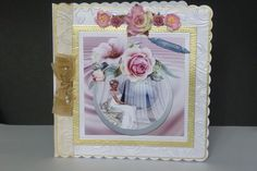 reflection wedding mini kit on Craftsuprint designed by Cynthia Berridge - made by kathleen  Peace - Used an 8 x 8 scalloped card used gold mat card and an embossed card for first mat and layer used wet glue to attach to card Also used a square die to make a mat and layer,to put topper on.Decoupage topper with silicon glue and used sticky fixers to attach to card.Embellishments used are .Organza ribbon a hat pin through bow and mulberry flowers.Sentiment on card is Congratulations.There is…