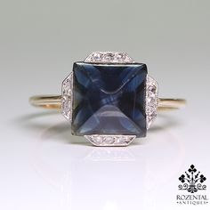 Period: Art deco (1920-1935) Composition: 18K Gold & Platinum. Stones: - 12 Rose cut diamonds of H-SI1 quality that weigh 0.15ctw. - 1 Natural sugarloaf cut sapphire that weighs 2.50ctw. Ring size: 7