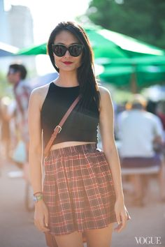 STREET STYLE CROP TOP CROSSBODY BAGS LOLLAPALOOZA FESTIVAL KAREN WALKER CAT EYE SUNGLASSES CROP BLACK TANK TOP PLAID HIGH WAIST SKIRT TAN CROSSBODY SATCHEL FESTIVAL INSPIRATION VOGUE