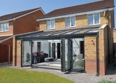 A contemporary veranda glass extension can transform your home. View our glass extension designs & request a free quote from your local supplier. Lean To Conservatory, Conservatory Extension, Conservatory Kitchen, Conservatory Design, Orangery Extension Kitchen, Victorian Conservatory, Cottage Extension, Glass Roof Extension, House Extension Design