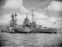 'R' class battleship HMS Resolution alongside 'Queen Elizabeth' class HMS Valiant early in WW2.  Though both mounted 8 x 15 in guns the 'R's (a later design) had reduced engine power to economise after the expense of the 'QEs'.  They had less scope for modernisation, being too slow, and overall were much less successful as a result.