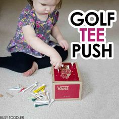 Try this fine motor skills activity with your toddler! Golf Tee Push is a quick and easy DIY toddler activity; lots of indoor activity fun; toddler activity