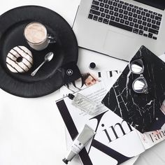 Donuts and magazine and laptop flatlay