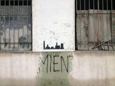 Graffiti con silueta de edificios en La Boca