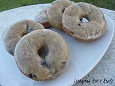 ~Glazed Blueberry Doughnuts~ Easy to mix, bake and so yummy to eat! These breakfast treats are perfect for the weekend! And did I mention the glaze? Oh the glaze...