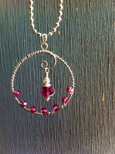 Wire wrapped raspberry swarovski crystal pendant
