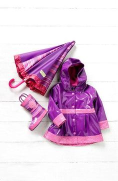 Absolutely adorable. Purple raincoat, boots, & umbrella.