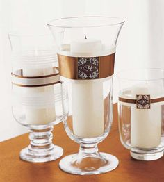 Include Elegant Candles.  Decorate short, medium, and tall glass hurricanes with ribbon sleeves and monograms and then fit with white pillar candles -- easy and elegant.