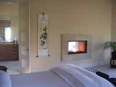 suite escape - modern - bedroom - other metro - COASTROAD Hearth & Patio    see through fireplace..just lower