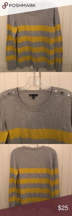 REDUCED! GAP Sweater Gray and yellow striped GAP sweater. Sweater has cute buttons on both shoulders and is in good condition with some minor pilliing around the underarms (as pictured). Sweater is Size L and is 55% cotton, 20% polyester, 20% nylon and 5% rabbit hair. GAP Sweaters Crew & Scoop Necks