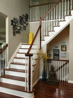 My newly decorated foyer. Walls are Benjamin Moore Revere Pewter. I popped Yellow & Blues as my accent color.