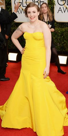 Lena Dunham adds a pop of colour to the red carpet with her striking Zac Posen number.