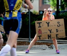 Description of . Kristen Freaney, of Lafayette, cheers for runners near the finish line during the Boulder Ironman on Sunday, Aug. 3, in Bou...