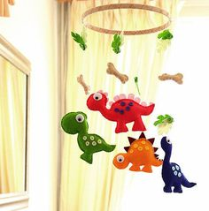 Welcome to FlossyTots This Dinosaur Mobile is MADE TO ORDER This mobile consists of four very colourful cute dinosaurs. Its been carefully designed, handcut, handstitched by myself using premium wool blend felt. Above each dinosaur are leaves and bones all hanging from a wooden hoop.
