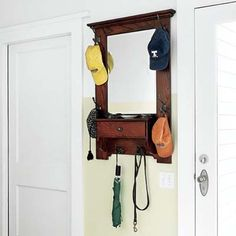 Hung between the back door and the entry to a crafts room, this vintage mirrored hat rack gives adults a chance to primp one last time before heading out for the day.