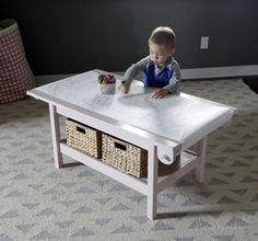 DIY Simple Kids Pine Play Table with Paper Roll Holder. Give your kids a place to be creative with this homemade craft table tutorial.
