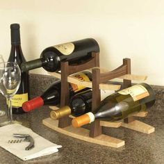 Wine Rack Woodworking Plan — This graceful countertop rack keeps your favorite wines at hand for dinner parties or entertaining. With just four parts—and full-size patterns for three of them—you can build the rack almost as quickly as you can say cabernet sauvignon. http://www.woodstore.net/winerack.html