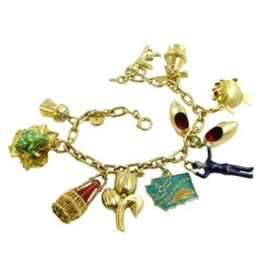 CARTIER Gold Bracelet with Charms | From a unique collection of vintage charm bracelets at https://www.1stdibs.com/jewelry/bracelets/charm-bracelets/