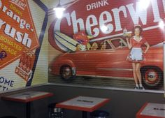 Check out D-Moe's Famous Hot Dogs in Charlotte, NC! They serve Cheerwine and have a sweet Cheerwine wall painting too!