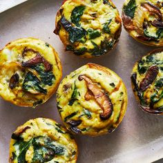 Switch up your morning routine with these easy vegetarian mini quiches. Earthy mushrooms and spinach pair nicely with rich and creamy Gruyère cheese. Serve them on a platter with a fresh fruit salad for a simple weekend brunch. Eggs In Muffin Tin, Muffin Tin Recipes, Egg Recipes, Cooking Recipes, Easter Recipes, Muffin Tin Quiche, Muffin Tin Breakfast, Quiche Muffins, Egg Muffins