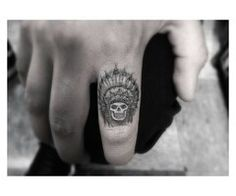 indian skull finger tattoo