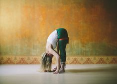 Uttanasana with Block Between Thighs and Strap