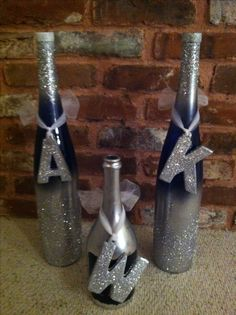 Easy! I sprayed the tall and short wine bottles (free from a friend) with silver metallic paint (Krylon), added glitter, sprayed the glass letters (clearanced at Michael's for .50 each) & added glitter, and painted the shorter wine bottle with chalkboard paint. Total cost: About $3.00 ~Melissa~