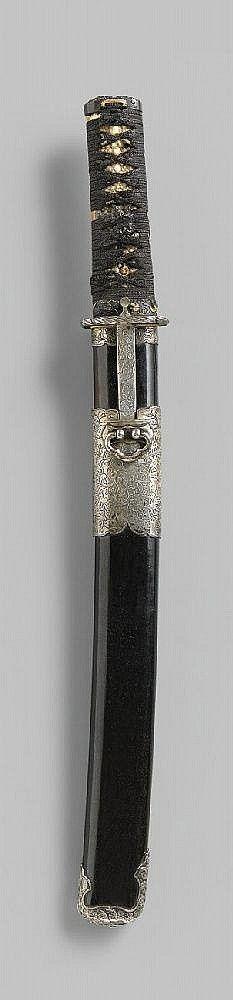 A tantô. Blade length 31,6 cm, hira zukuri with bôhi on both sides, hamon: gunome-midare with nie, hada: masame-mokume. Nakago: ubu, two mekugi-ana, mei: Kunitsugu, silver plated habaki. Koshirae: Iron tsuba with waves in relief, silver rim, fuchi-kashira of shibuichi with dragon in relief, silver kojiri with tiger and bamboo, kurigata in shape of a wide band of silver and silver kozuka und kôgai engraved with tendrils and waves, menuki: shishi of shakudô. Saya: polished wood. 19th century.