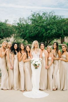"""From the editorial """"A Cabo Wedding Complete With a Veuve Clicquot Champagne Truck and Surprise Firework Show!"""" We're crushing hard on these bridesmaid gowns. Just wait until you see the rest of this dreamy destination wedding!  Photography: @seancookweddings Bride Dress: @efbridal Bridesmaid Dresses: @stone_cold_fox  #bridesmaiddresses #goldbridesmaiddresses #tanbridesmaiddresses #neutralbridesmaiddresses Stone Bridesmaid Dress, Champagne Colored Bridesmaid Dresses, Gold Brides Maid Dresses, Winter Wedding Bridesmaids, Neutral Bridesmaid Dresses, Bridesmaid Gowns, Champagne Color Wedding, Destination Bridesmaid Dresses"""