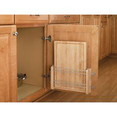 I like the idea of using doors. choices choices (A Kitchen Space Saver: The Door-Mount Cutting Board from Rev-A-Shelf — Small Space Living) Cutting Board Storage, Wood Cutting Boards, Chopping Boards, Kitchen Pantry, New Kitchen, Kitchen Ideas, Kitchen Small, Kitchen Cabinets, Kitchen Sink