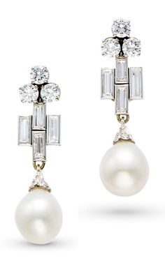 A FINE PAIR OF ART DECO NATURAL PEARL AND DIAMOND EAR PENDANTS. Each suspending a natural pearl drop measuring 9.64 - 10.07 x 11.30 mm and 10.01 - 10.14 x 11.25 mm, suspended to a geometric-shaped surmount set with baguette- and brilliant- cut diamonds, mounted in 18K white gold, 3.6 cm long. #ArtDeco #earrings
