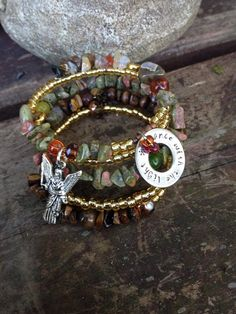 Dance with the Light: five wrap memory wire beaded bracelet with metal stamped charm on Etsy, $40.00