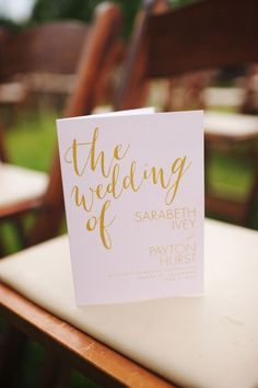 Pink and gold wedding programs Love the idea of neatly placing them on the chairs ahead of time :)