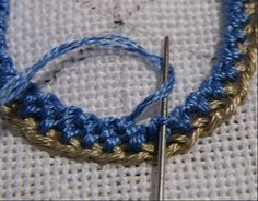 Crewel Embroidery Tutorial spiral trellis 8 - Spiral Trellis can be worked either with knotty trellis, like Version which makes spiral ridges, or with smooth trellis, which has a flatter surface. The multicoloured circle below is knotty spi… Brazilian Embroidery Stitches, Embroidery Stitches Tutorial, Crewel Embroidery Kits, Hand Embroidery Patterns, Embroidery Techniques, Ribbon Embroidery, Cross Stitch Embroidery, Embroidery Shop, Embroidery Needles