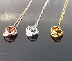 Ring infinity necklace Three ring necklace by jewelrycraftstudio, $27.50 My favorite is the silver one because it would match most of my earrings.