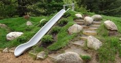 10 Stunning Landscape Ideas for a Sloped Yard | Natural Playgrounds, Playgrounds and Elementary Schools