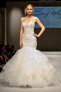 Wedding gown by Eve of Milady.