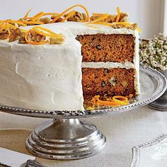 Carrot Cake with Chèvre Frosting | Substituting goat cheese for the standard cream cheese gives this frosting an extra-tangy kick. | SouthernLiving.com