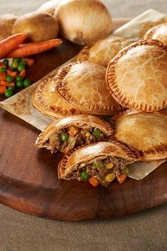 Shepherd's Pie Hand Pies -1/2 lb ground beef  1 cup onion, chopped  1 medium Yukon gold potato, peeled and diced  1/2 cup carrot, diced  1/4 cup frozen peas  1/4 cup frozen corn  2 Tbsp Worcestershire sauce  1/2 cup canned chicken gravy  1 egg  1 Tbsp water  2 boxes (4 rolls) pre-made pie crust  8 slices American cheese, quartered